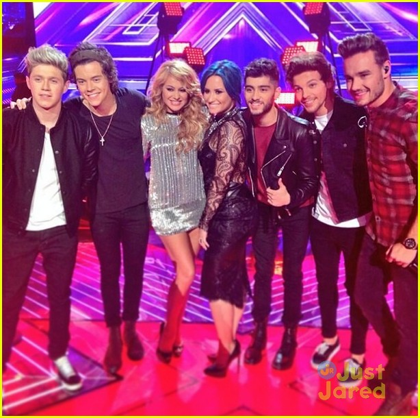 Demi Lovato Poses With One Directions Zayn Malik And Louis Tomlinson During Thefactor Season Finale On Thursday Night DecemberIn Los Angeles