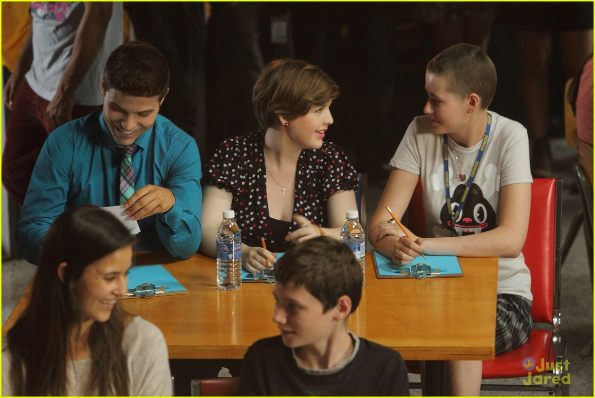 Clare (Aislinn Paul) and Drew (Luke Bilyk) sit side-by-side in this