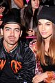 Jonas-custo joe jonas blanda eggenschwiler sit together at custo barcelona fashion show 04