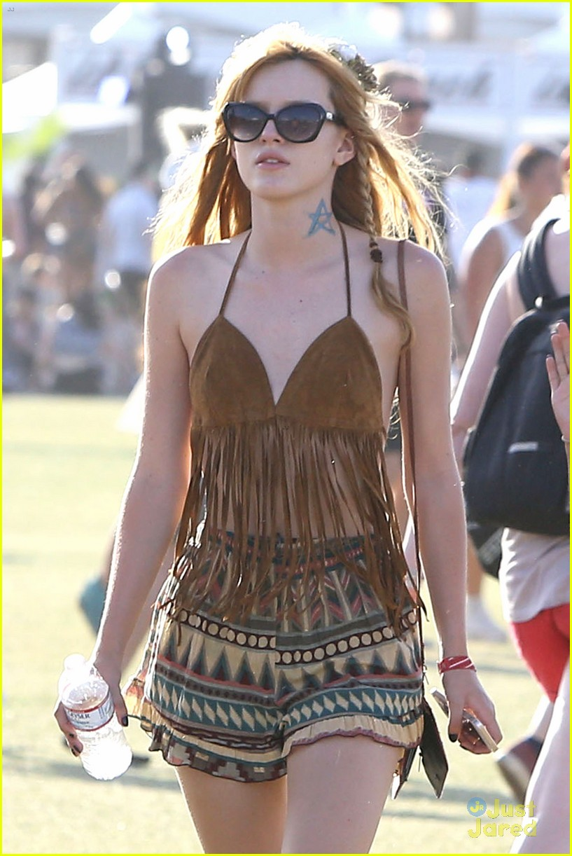http://cdn01.cdn.justjaredjr.com/wp-content/uploads/pictures/2014/04/bella-boho/bella-thorne-closes-out-coachella-shirtless-tristan-klier-02.jpg