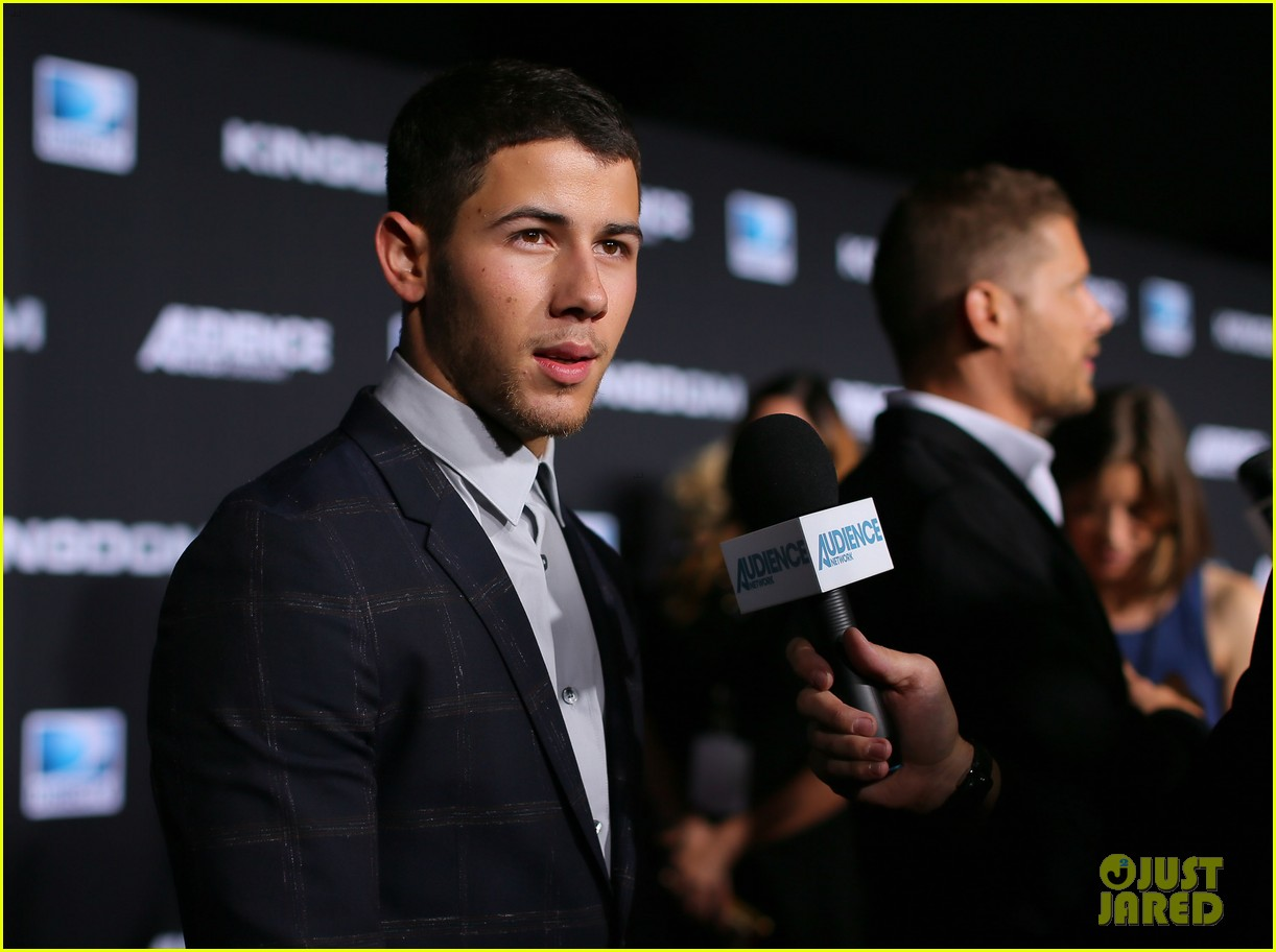 full sized photo of nick jonas poses shirtless in his