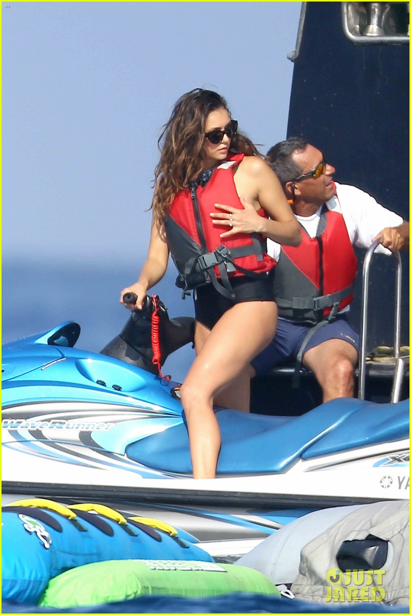 Nina Dobrev Hits The Waves While Vacationing With Friends