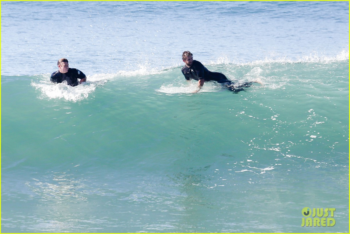 liam hemsworth goes for monday morning surf session with brother luke 04