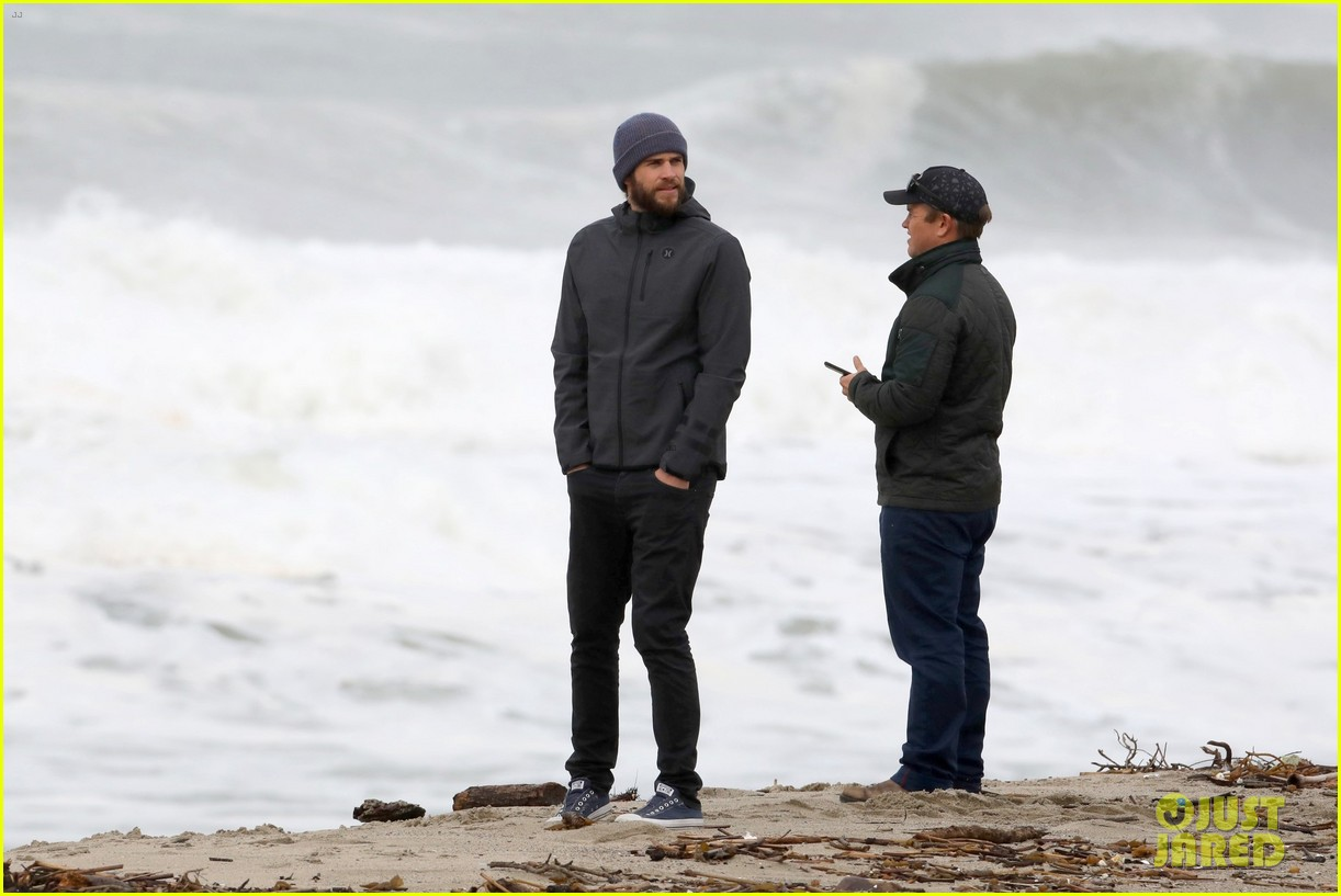 liam hemsworth and brother luke check out surf after socal storm 05