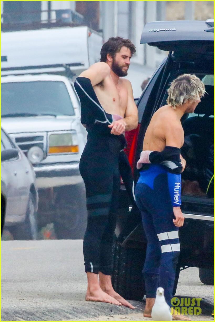 liam hemsworth strips shirtless surfing 03