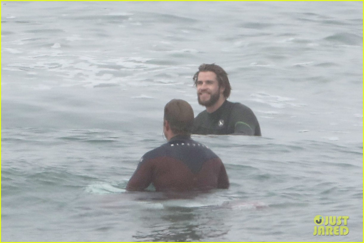 liam hemsworth strips out of wetsuit to reveal ripped abs 64