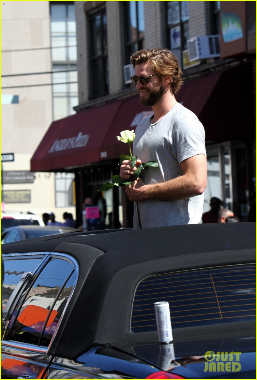 liam hemsworth has a flower for rebel wilson on isnt it romantic set 03