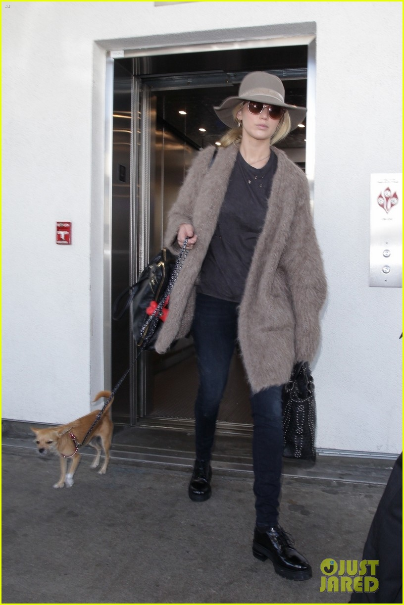 jennifer lawrence arrives at lax with her cute dog in tow 01