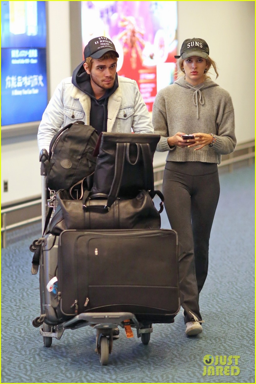 kj apa arrives in vancouver with mystery blonde 05